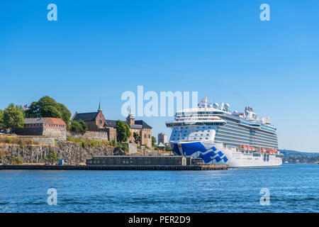 Regal Princess cruise liner in front of Akershus Fortress (Akershus Festning) and Akershus Castle (Akershus Slott), Oslo, Norway - Stock Photo