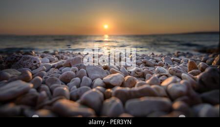 Beach pebbles at sunset, close up macro - Stock Photo