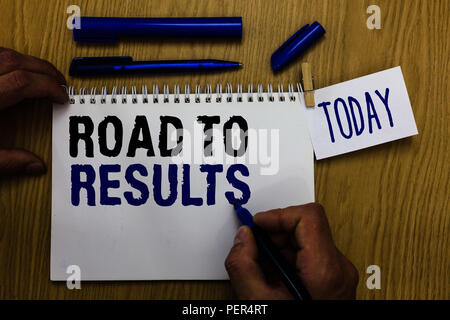 Handwriting text Road To Results. Concept meaning Business direction Path Result Achievements Goals Progress Man holding marker notebook clothespin re - Stock Photo