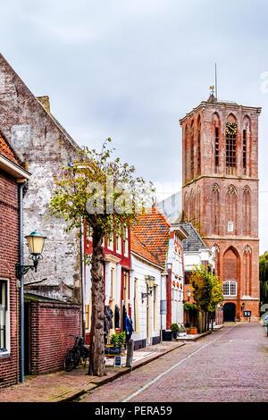 Historic Brick Houses in 14th century old Dutch fishing village of Elburg - Stock Photo