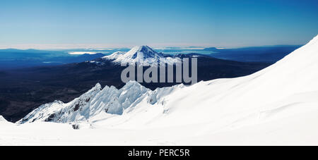 View of Mount Ngauruhoe and Tongariro from the top of Mount Rupaehu in winter. New Zealand, National Park, Tongariro - Stock Photo