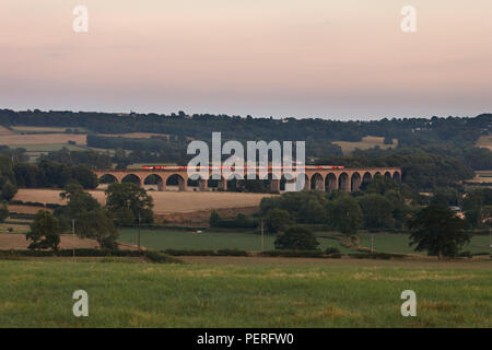 A LNER High speed train ( Intercity 125 ) crossing Wharfedale viaduct over the River Wharf on the  Leeds - Harrogate line running emty to the depot - Stock Photo