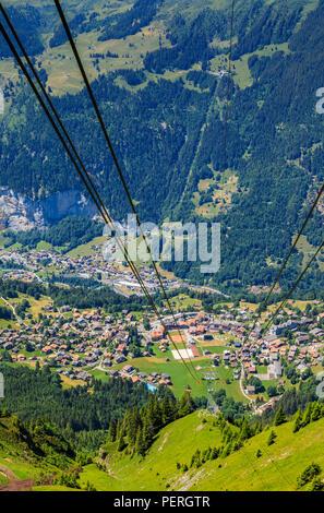 Aerial view of Wengen village centre, Lauterbrunnen and the Lauterbrunnen Valley from the Maennlichen cablecar, Jungfrau region, Switzerland - Stock Photo