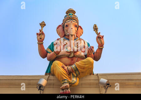 Sculpture of Ganesh (Ganesha) elephant god on the roof of the Sri Mariamman hindu temple in Singapore - Stock Photo