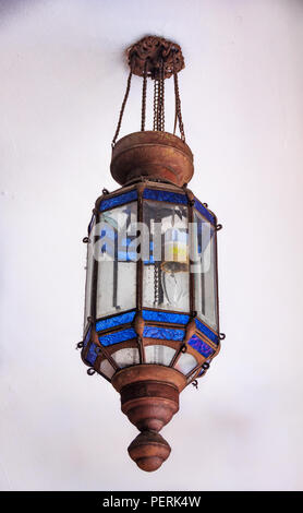 Intricate old street lamp with ornate blue glass and copper detailing in Chinatown in Singapore - Stock Photo