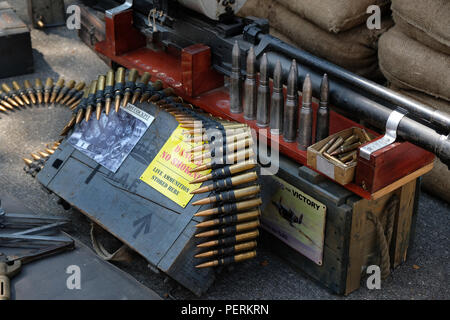Display of aircraft weapons from world war two. 0.303, 0.5 and 20 mm ammunition and guns. - Stock Photo