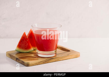 Watermelon smoothie on wood background , healthy drink - Stock Photo