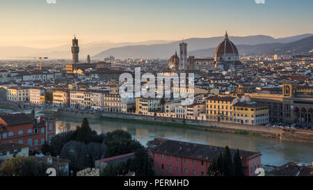 Florence, Italy - March 22, 2018: Landmarks including the Duomo cathedral and Palazzo Vecchio stand in the Renaissance cityscape of Florence, with the - Stock Photo