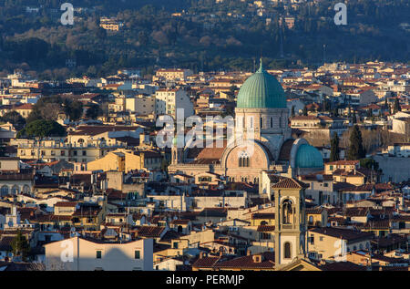Florence, Italy - March 22, 2018: The Synagogue of Florence rises from streets of traditional houses in the city. - Stock Photo