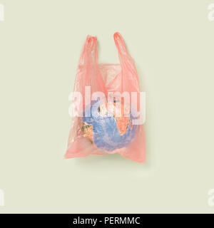 The globe in a plastic bag, the concept of global pollution - Stock Photo
