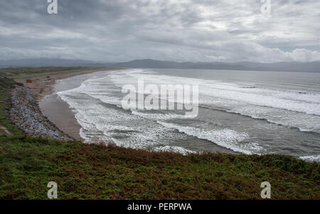 Waves break on the beach at Inch Strand, a sand dune system in Dingle Bay on the west coast of Ireland's County Kerry. - Stock Photo