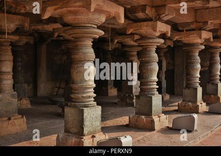 'Interesting view of the black stone pillars in a double storeyed hall near Monolithic Bull of Virupaksha temple, Hampi - Karnataka' - Stock Photo