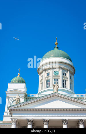 Finland tourism summer, view of a Finnair jet flying high over the Helsinki Lutheran Cathedral on a summer day, Finland. - Stock Photo