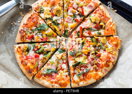 Pizza with chicken, bacon and vegetables - Stock Photo