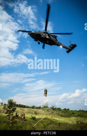 U.S. Marines with Black Sea Rotational Force 18.1 execute a medical evacuation drill during Exercise Platinum Lion 18 at Novo Selo Training Area, Bulgaria, Aug. 7, 2018. Platinum Lion is an annual field training exercise that reinforces relationships in a joint training environment, builds understanding of partner nation tactics, techniques and procedures, and increases interoperability with Allied and partner forces.  (U.S. Marine Corps photo by Lance Cpl. Angel D. Travis/Released) - Stock Photo