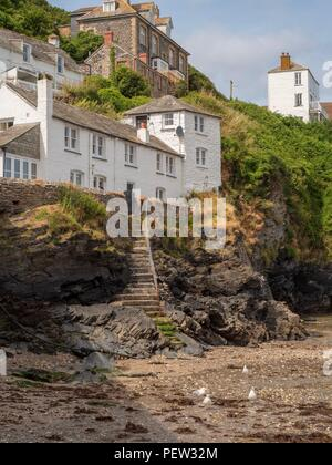 Houses built on the cliff at the harbour for Port Isaac in Cornwall - Stock Photo