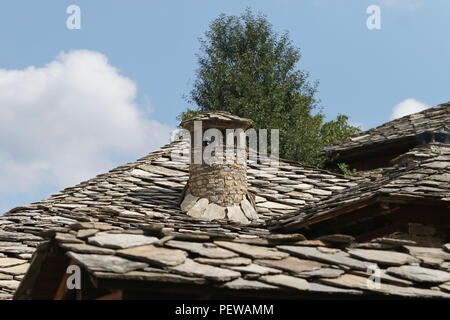 Old chimney on house in Kovachevitsa village - Stock Photo