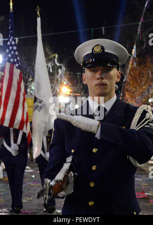 A member of the Coast Guard Ceremonial Honor Guard marches down the streets of New Orleans during the 2016 Bacchuc Mardi Gras Parade while performing a rifle routine, Feb. 7, 2016. Members of the Coast Guard Ceremonial Honor Guard perform silent drills around the country as representatives of the Coast Guard. (U.S. Coast Guard photo by Petty Officer 2nd Class Jonathan Lally) - Stock Photo