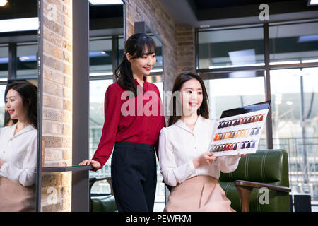 Hairdresser styling woman's hair in a salon. Korean beauty stock photo. 147 - Stock Photo