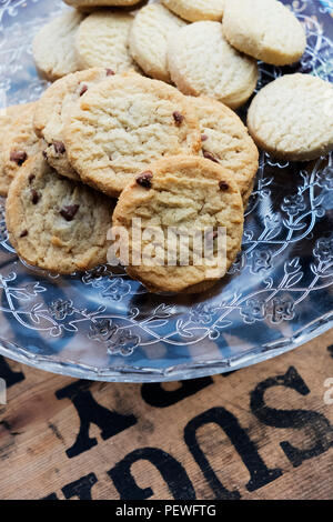 High angle close up of chocolate chip cookies on a glass plate. - Stock Photo