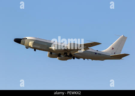 MILDENHALL, UK - JUL 12, 2018: Royal Air Force Boeing RC-135W Rivet Joint military reconnaissance aircraft taking of from RAF Mildenhall airbase. - Stock Photo