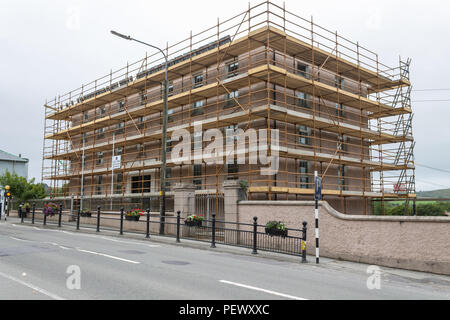 Old School building covered in Scaffolding, ireland - Stock Photo