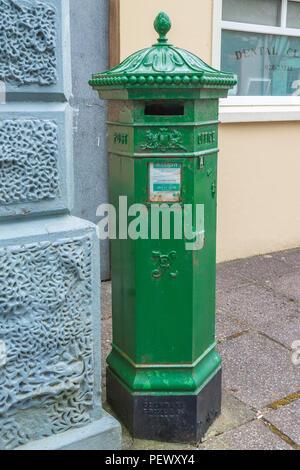 Cast Iron Irish post box painted green. - Stock Photo
