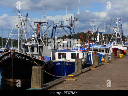 Some of the many fishing boats, that come to the small fishing village of Tarbert, Loch Fyne, tied up along the quayside. - Stock Photo