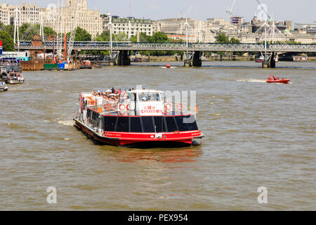 Sightseeing cruise ship, City Cruises on the River Thames with Jubilee and Hungerford bridge in the background.London, England - Stock Photo