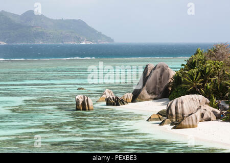 View from the well known observation point to the famous Anse Source D'Argent in La Digue, Seychelles, with Praslin in the background. - Stock Photo