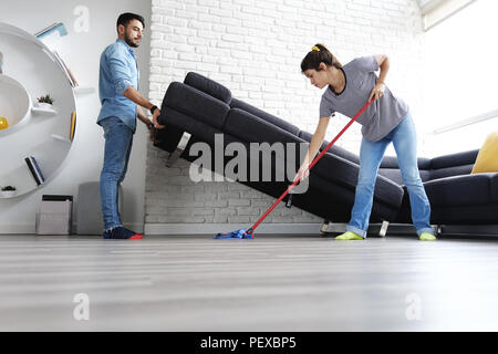 Man And Woman Doing Chores Cleaning Floor - Stock Photo