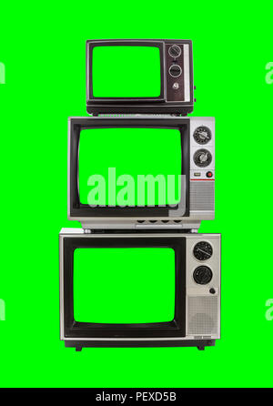 Vintage television tower isolated with chroma green background and screens. - Stock Photo