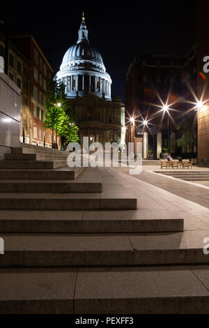 St Paul's Cathedral from peter's Hill at night with steps in foreground, City of London, UK - Stock Photo