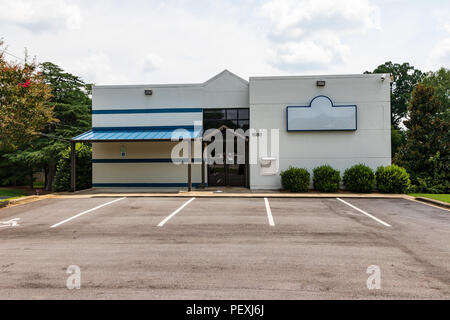 HICKORY, NC, USA-15 AUGUST 18: An empty commercial building along a main street. - Stock Photo