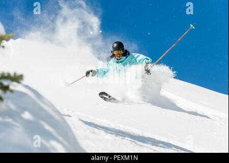 Person skiing down hill, Crested Butte, Colorado, USA - Stock Photo