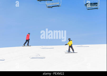 Men snowboarding down ski slope, Crested Butte, Colorado, USA - Stock Photo
