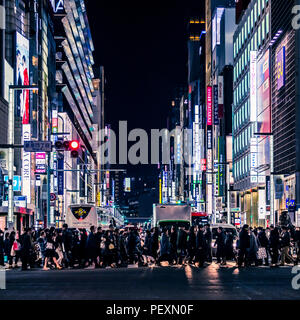 Crowd of people on street in Ginza district, Tokyo, Japan - Stock Photo