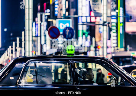 Taxi on street in Ginza district, Tokyo, Japan - Stock Photo