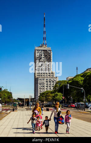 Family walking on street in Buenos Aires, Argentina - Stock Photo
