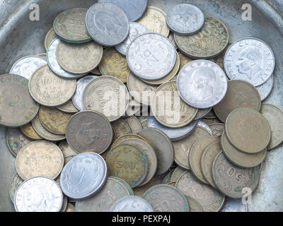 old turkish coins in the metal plate - Stock Photo