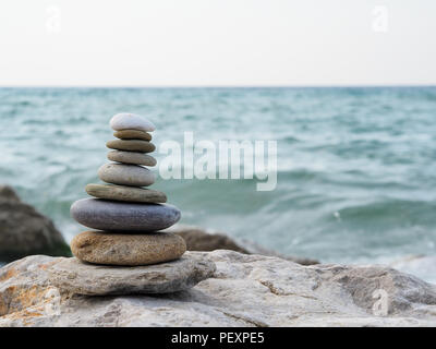 tower and blur background made of stones by the sea - Stock Photo