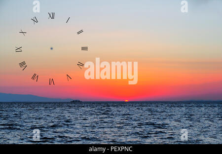sun setting over the sea and ship in turkey for wall clock - Stock Photo