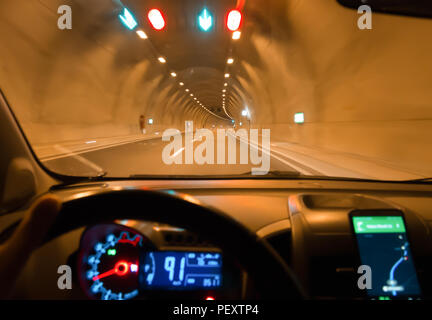 night driving car and navigation on the phone in tunnel - Stock Photo