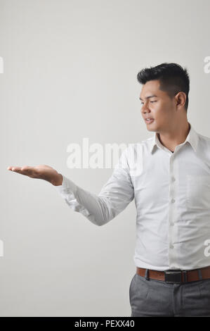 Asian male cupped palms - Stock Photo