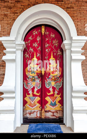 Red and gold decorated door on a Buddhist Temple above Chiang Mai in the mountians. - Stock Photo