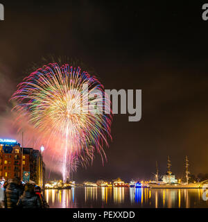 Fireworks in Bergen, Norway, at New years eve celebration. - Stock Photo
