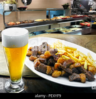 Picanha with fries and beer - Stock Photo