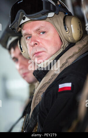 Polish Navy CDR Miroslav Zachariasz with Naval Striking and Support Forces NATO takes a familiarization ride aboard an MV-22 Osprey with Marine Medium Tiltrotor Squadron 263, Special-Purpose Marine Air-Ground Task Force-Crisis Response-Africa, at AT-1 Lisbon airport, Portugal, Feb. 11, 2016. SPMAGTF-CR-AF demonstrated the MV-22 Osprey's capabilities to STRIKFORNATO in order to familiarize other nations with capabilities for possible future military training and operations. (U.S. Marine Corps photo by Sgt. Kassie L. McDole/Released) - Stock Photo