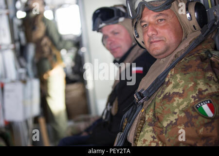 Polish Navy CDR Miroslav Zachariasz, (left), and Italian Navy LCDR Savatore Lo Pilato, (right), with Naval Striking and Support Forces NATO, familiarizes themselves with the capabilities of the MV-22 Osprey during a familiarization ride with Marine Medium Tiltrotor Squadron 263, Special-Purpose Marine Air-Ground Task Force-Crisis Response-Africa, at AT-1 Lisbon airport, Portugal, Feb. 11, 2016. SPMAGTF-CR-AF demonstrated the MV-22 Osprey's capabilities to STRIKFORNATO in order to familiarize other nations with capabilities for possible future military training and operations. (U.S. Marine Corp - Stock Photo