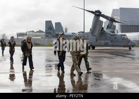 Multinational service members with Naval Striking and Support Forces NATO disembark an MV-22 Osprey following a familiarization ride with Marine Medium Tiltrotor Squadron 263, Special-Purpose Marine Air-Ground Task Force-Crisis Response- Africa, at AT-1 Lisbon airport, Portugal, Feb. 11, 2016. SPMAGTF-CR-AF demonstrated the MV-22 Osprey's capabilities to STRIKFORNATO in order to familiarize other nations with capabilities for possible future military training and operations. (U.S. Marine Corps photo by Sgt. Kassie L. McDole/Released) - Stock Photo